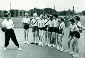 Instruction from the expert, Miss Hilary Peet, physical education mistress, who plays netball for Lancashire and who is also a member of the County swimming team. Source: Lancashire Life Magazine, November 1958